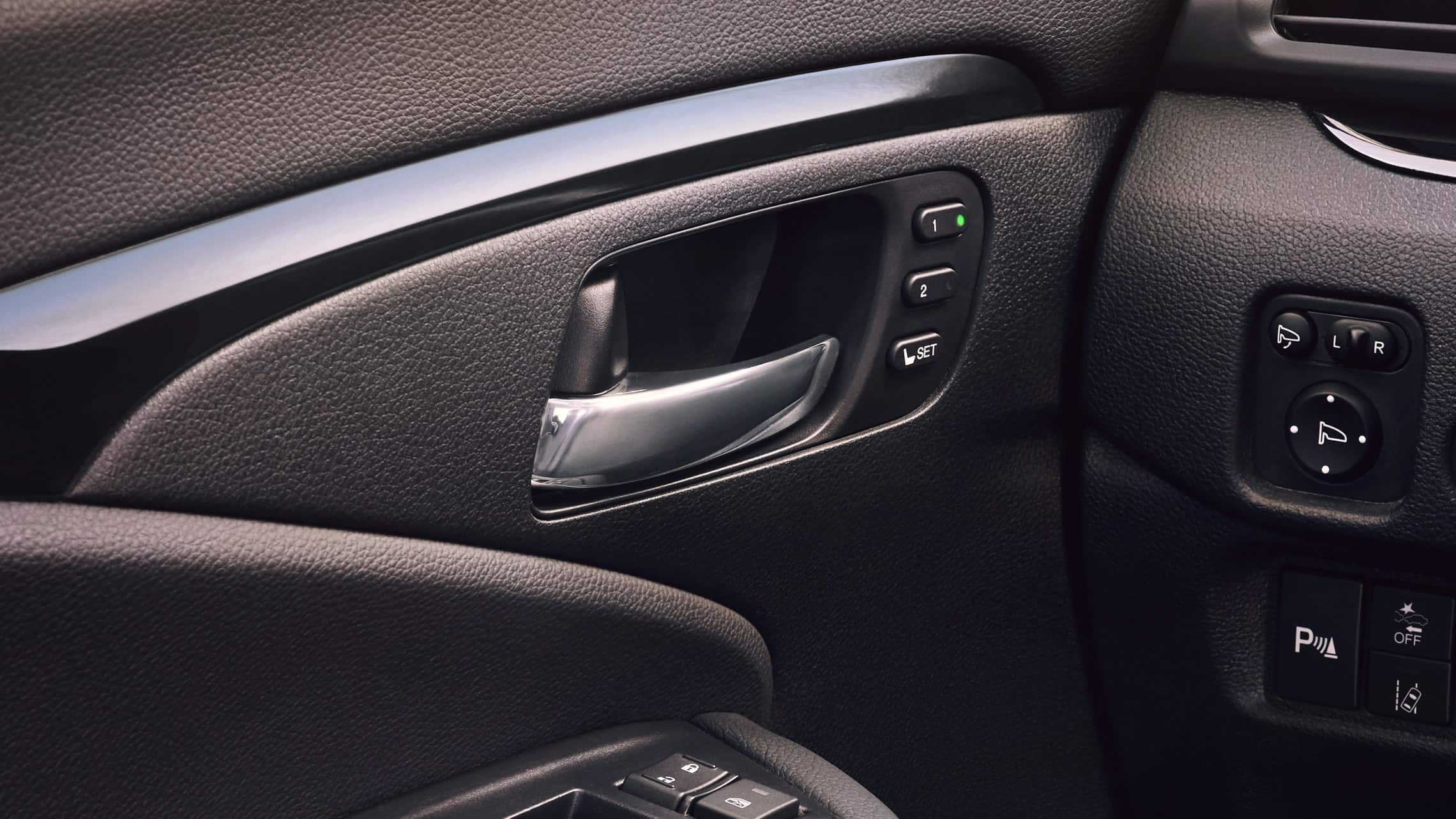 Driver's seat memory setting detail on the 2019 Honda Passport Elite with Black Leather interior.