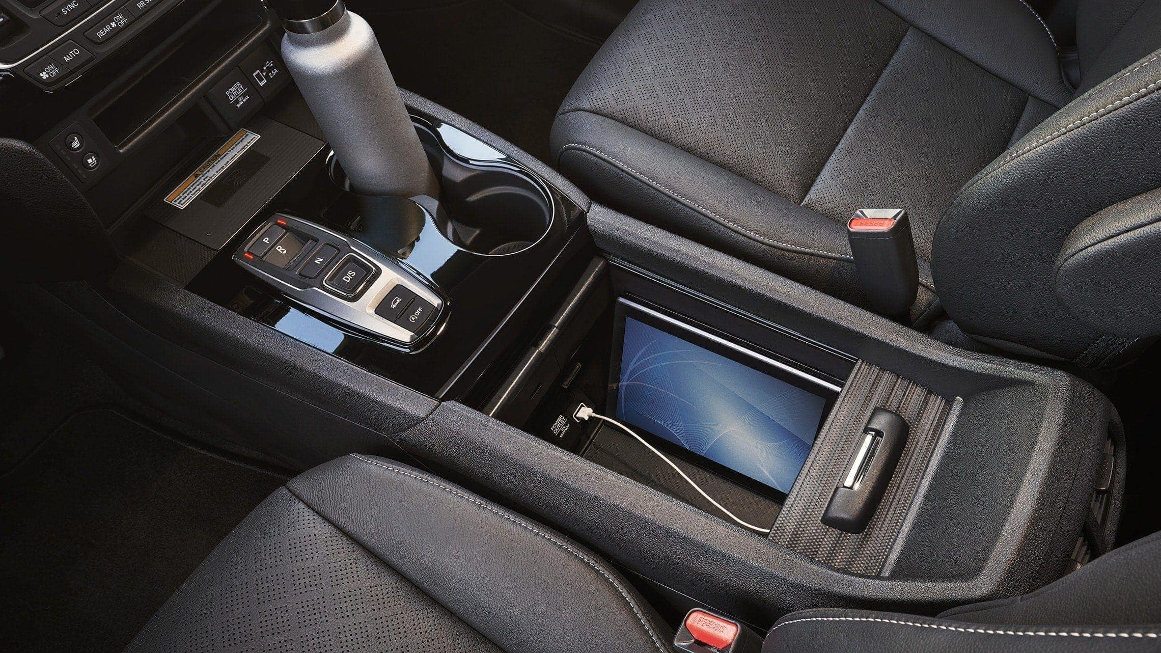 2019 Honda Passport Elite with Black Leather interior displaying multi-functional center console.