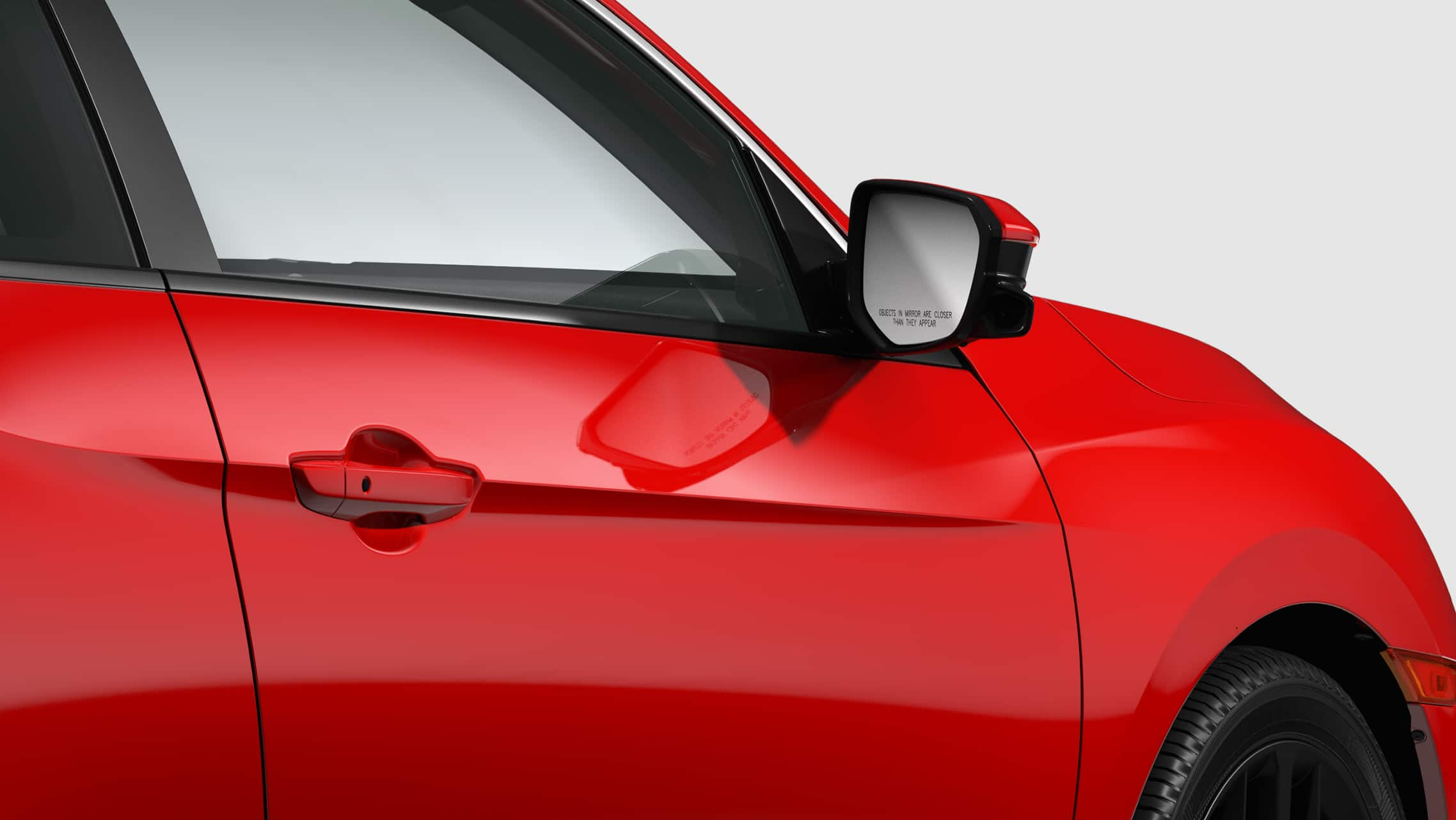 Honda LaneWatch™ camera detail on passenger's side mirror on 2020 Honda Civic Si Coupe in Rallye Red.