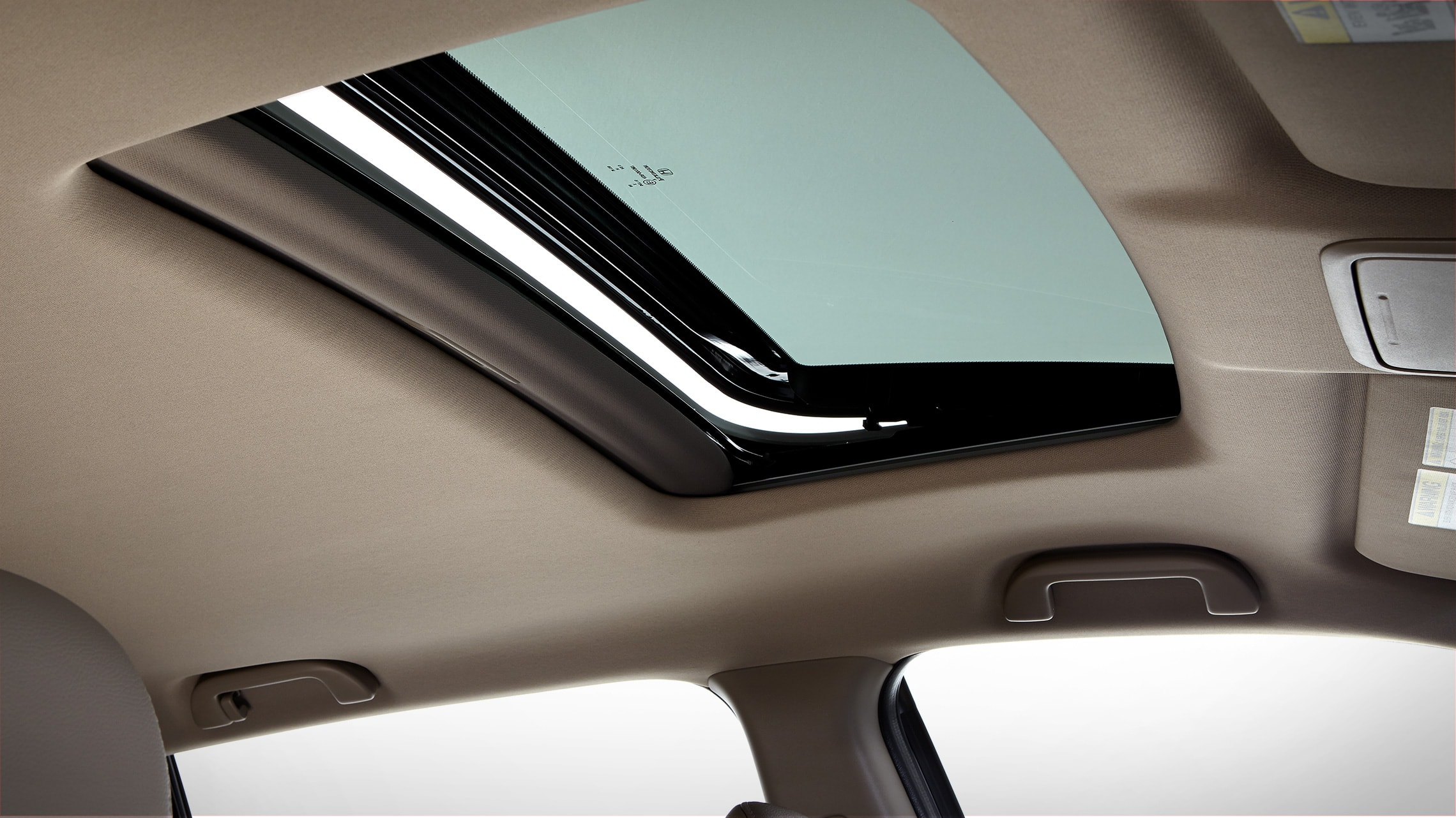 One-touch power moonroof detail in the 2020 Honda Ridgeline ETL-E with Beige Leather.